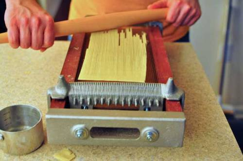 David Rowlett Rolling Dough Over a Chitarra